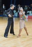 Berufstanz-Paare von Kosyakov Egor und von Navoychik Anna Performs Adults Latin-American Program Stockbild