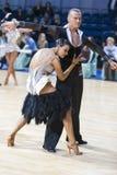 Berufstanz-Paare von Kuzin Evgeny und von Fedoseeva Anastasia Performs Adults Latin-American Program Stockbild