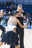 Berufstanz-Paare von Kuzin Evgeny und von Fedoseeva Anastasia Performs Adults Latin-American Program Lizenzfreies Stockbild
