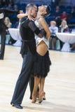 Berufstanz-Paare von Kuzin Evgeny und von Fedoseeva Anastasia Performs Adults Latin-American Program Stockfotos