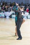 Berufstanz-Paare von Trach Stanislav und von Odobescu Anastasia Performs Adults Latin-American Program Lizenzfreie Stockfotos