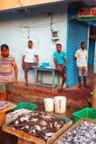 Beruwala, Sri Lanka - 10 February, 2017: Group of sellers and customers bargain at fish market in Bentota or Aluthgama area. Beruwala, Sri Lanka - 10 February stock photos