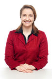 Überzeugter blinkender Unternehmensleiter ein Lächeln Lizenzfreie Stockbilder