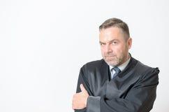 Überzeugter Geschäftsmann mit einem spekulativen Blick Stockbilder