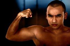 Überzeugter muskulöser Mann Stockfotos
