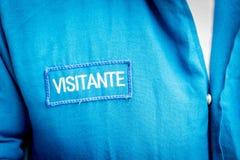 Besökaresparre i spanjor på en blå overall Fotografering för Bildbyråer