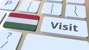 BES?Ktext och flagga av Ungern p? knapparna p? datortangentbordet Begreppsm?ssig animering 3D arkivfilmer