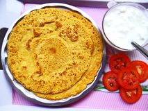 Besan chilla. Savory spiced pancakes made with gram flour with chilli sauce and a quick breakfast stock photos