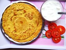 Besan chilla. Savory spiced pancakes made with gram flour with chilli sauce and a quick breakfast stock image