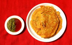 Besan chilla : quick breakfast. Besan chilla : savory spiced pancakes made with gram flour with chilli sauce and a quick breakfast stock image