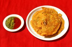 Besan chilla : quick breakfast. Besan chilla : savory spiced pancakes made with gram flour with chilli sauce and a quick breakfast stock photos
