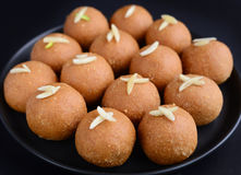 Besan laddoo. Gram flour, clarified butter and sugar truffles made during Indian festivals royalty free stock image