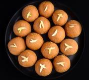 Besan laddoo  top iew. Besan laddoo- gram flour, clarified butter and sugar truffles made during Indian festivals Stock Photos