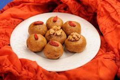 Besan laddu, handmade vegan sweets with wallnuts and goji berrie Royalty Free Stock Photos