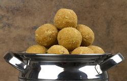 Besan Laddu. Special Traditional indian sweet food `Besan Laddu` made of gram flour, dry fruits, coconuts and other spices royalty free stock photo