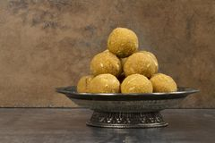 Besan Laddu. Special Traditional indian sweet food `Besan Laddu` made of gram flour, dry fruits, coconuts and other spices stock photos