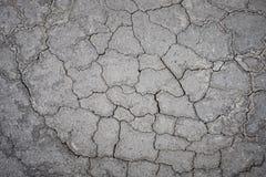Beschadigde asfalt concrete textuur als achtergrond Royalty-vrije Stock Afbeeldingen