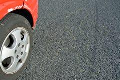 Beschadigde auto en wegoppervlakte Stock Fotografie