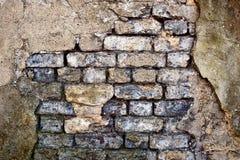 Beschadigde teruggegeven bakstenen muur Royalty-vrije Stock Foto's