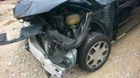 Beschadigde zwarte auto Stock Foto