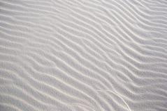 Beschaffenheit auf dem weißen Sand Stockfotografie