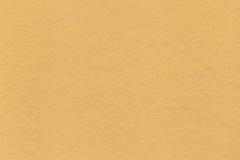 Beschaffenheit der alten hellgelben Papiernahaufnahme Struktur einer dichten Pappe Der goldene Hintergrund Lizenzfreies Stockbild