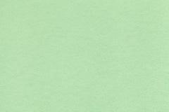 Beschaffenheit der alten hellgrünen Papiernahaufnahme Struktur einer dichten Pappe Der tadellose Hintergrund Lizenzfreie Stockfotos