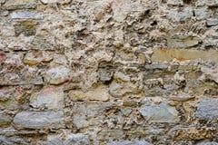 Beschaffenheit der alten mittelalterlichen Schlosswand hergestellt von den grauen Steinen Lizenzfreies Stockbild
