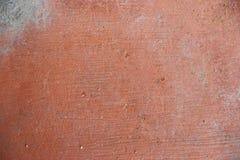 Beschaffenheit der alten rustikalen Wand bedeckt mit rotem Stuck Stockfotos
