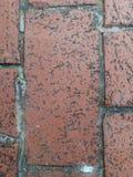 Beschaffenheit Der Bereich wird mit vielen kleinen quadratischen grauen Steinen gezeichnet stockfotografie