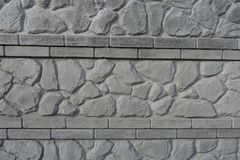 Beschaffenheit der Betonmauer mit Stein mögen Muster Stockbild