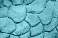 Beschaffenheit der blauen Wand vergipst in der Form von Steinen Lizenzfreie Stockfotos