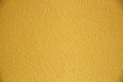 Beschaffenheit der gelben Farbe auf der Wand Lizenzfreies Stockfoto