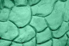Beschaffenheit der grünen Wand in der Form von großen Steinen Stockfotos