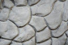 Beschaffenheit der grauen Wand vergipst in der Form von Steinen Stockfoto