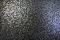 Beschaffenheit der orange Schale und des Lederimitats der schwarzen Farbe für einen abstrakten Hintergrund und für Tapete Lizenzfreie Stockbilder