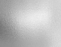 Beschaffenheit der silbernen Folie Stockbilder