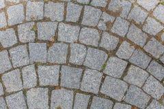 Beschaffenheit der Steinpflasterung deckt Kopfsteinhintergrund mit Ziegeln Lizenzfreies Stockbild