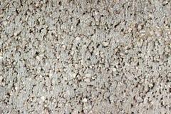 Beschaffenheit der Struktur der Betondecke mit Brüchen der kleinen Steinnahaufnahme Lizenzfreies Stockbild