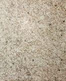 Beschaffenheit der Struktur des Betondeckebodenbrauns mit Brüchen der kleinen Steinnahaufnahme Lizenzfreies Stockbild
