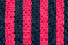 Beschaffenheit der vertikalen schwarzen rosa Streifen der Wollen Stockfoto