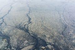 Beschaffenheit des Öls und des Schlammes auf dem Strand Lizenzfreies Stockfoto