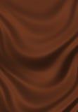 Beschaffenheit des braunen Schokoladenseideabschlusses oben Lizenzfreies Stockbild