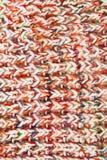 Beschaffenheit des bunten gestrickten Schals Stockfotografie