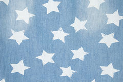 Beschaffenheit des Denimblue jeans-Hintergrundes mit Sternen Stockbild