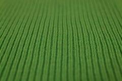 Beschaffenheit des gestricktem grünem Gewebemakro Lizenzfreies Stockbild