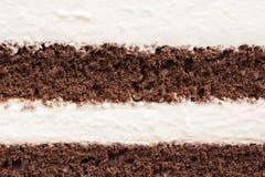 Beschaffenheit des Kremeis- und Schokoladenkuchens lizenzfreies stockbild