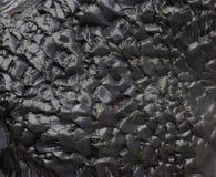 Beschaffenheit des nassen schwarzen Felsens Lizenzfreies Stockbild