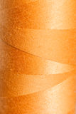 Beschaffenheit des orange Threads Stockbild