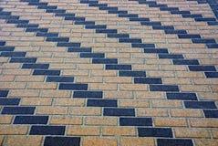 Beschaffenheit des Pflastersteins der Ziegelsteine auf der Straße Stockbilder